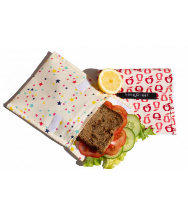 Two reusable and washable sandwich baggies with a sandwich inside