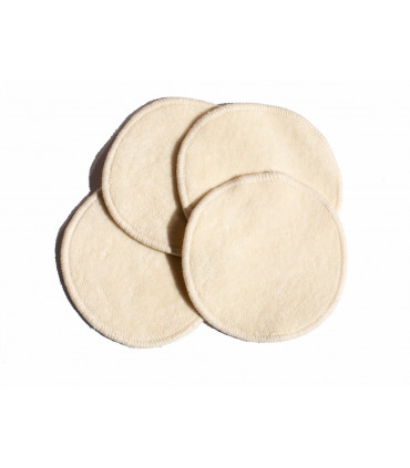 Four reusable and washable organic cotton make up remover pads on top of each other