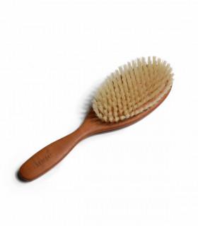 Brosse à cheveux en bois de poirier et soies de chèvres, de la marque Anaé