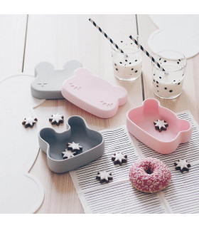 We might be tiny cat and bunny snackie silicone boxes on table with cookies