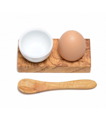 Olive wood egg holder and a little spoon with a porcelain ramekin