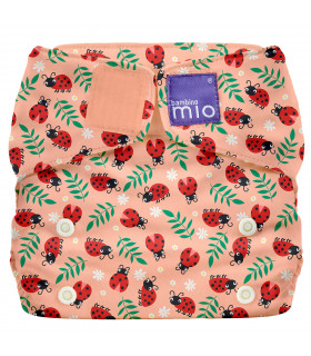 Closed up All in One reusable nappy with pink and loveable ladybug pattern