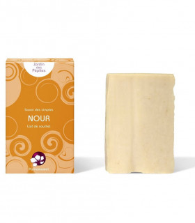 Pachamamai Nour cream colored exfoliating bar soap with cardboard package on the side
