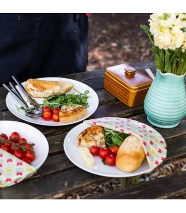 three served plates with food protected by beeswax coated food wraps