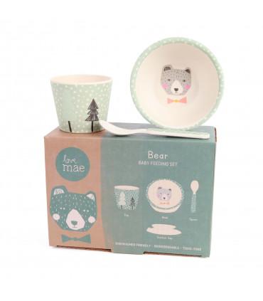 Coffret vaisselle en bambou posé sur son emballage en carton, motif ours
